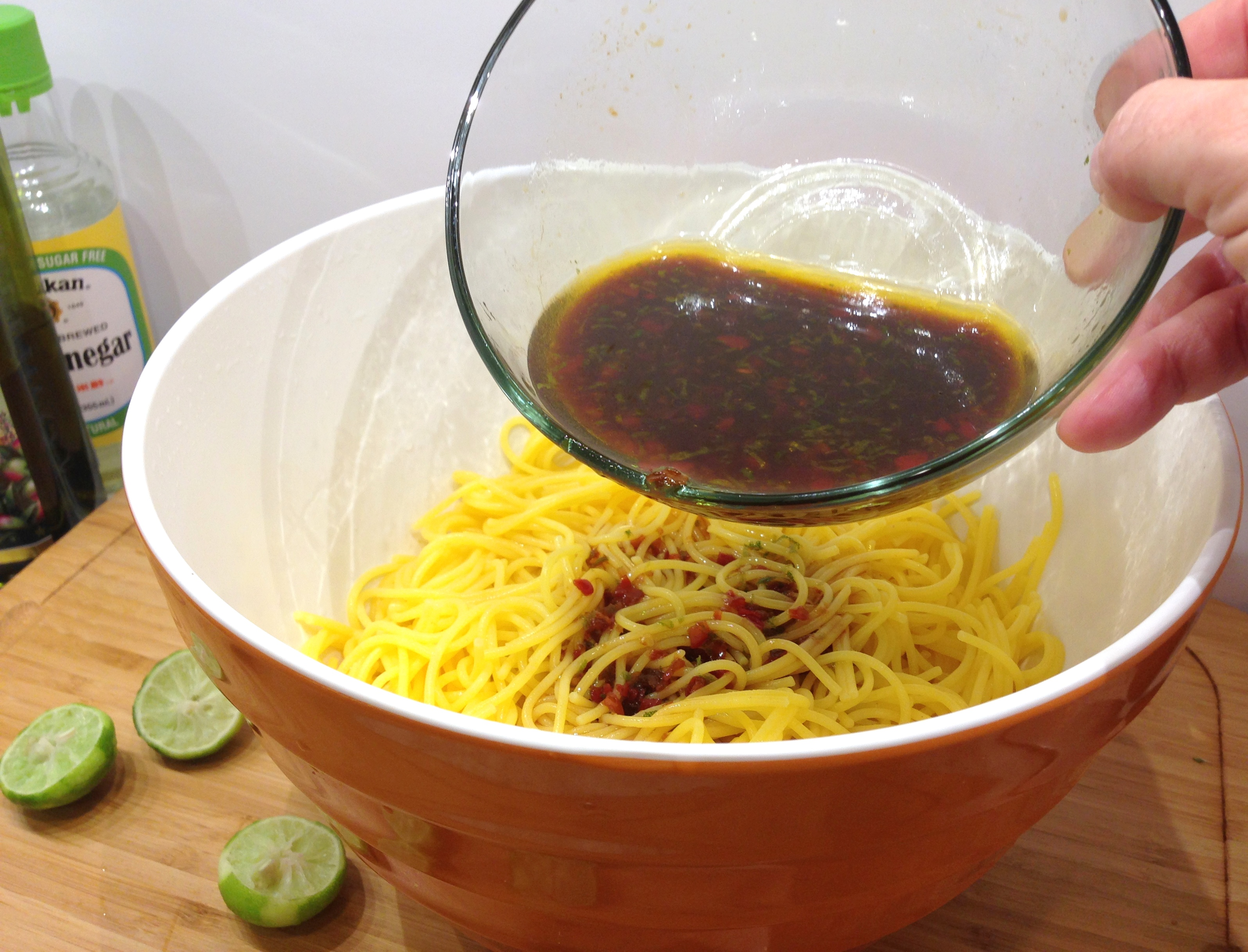 Toss noodles in dressing