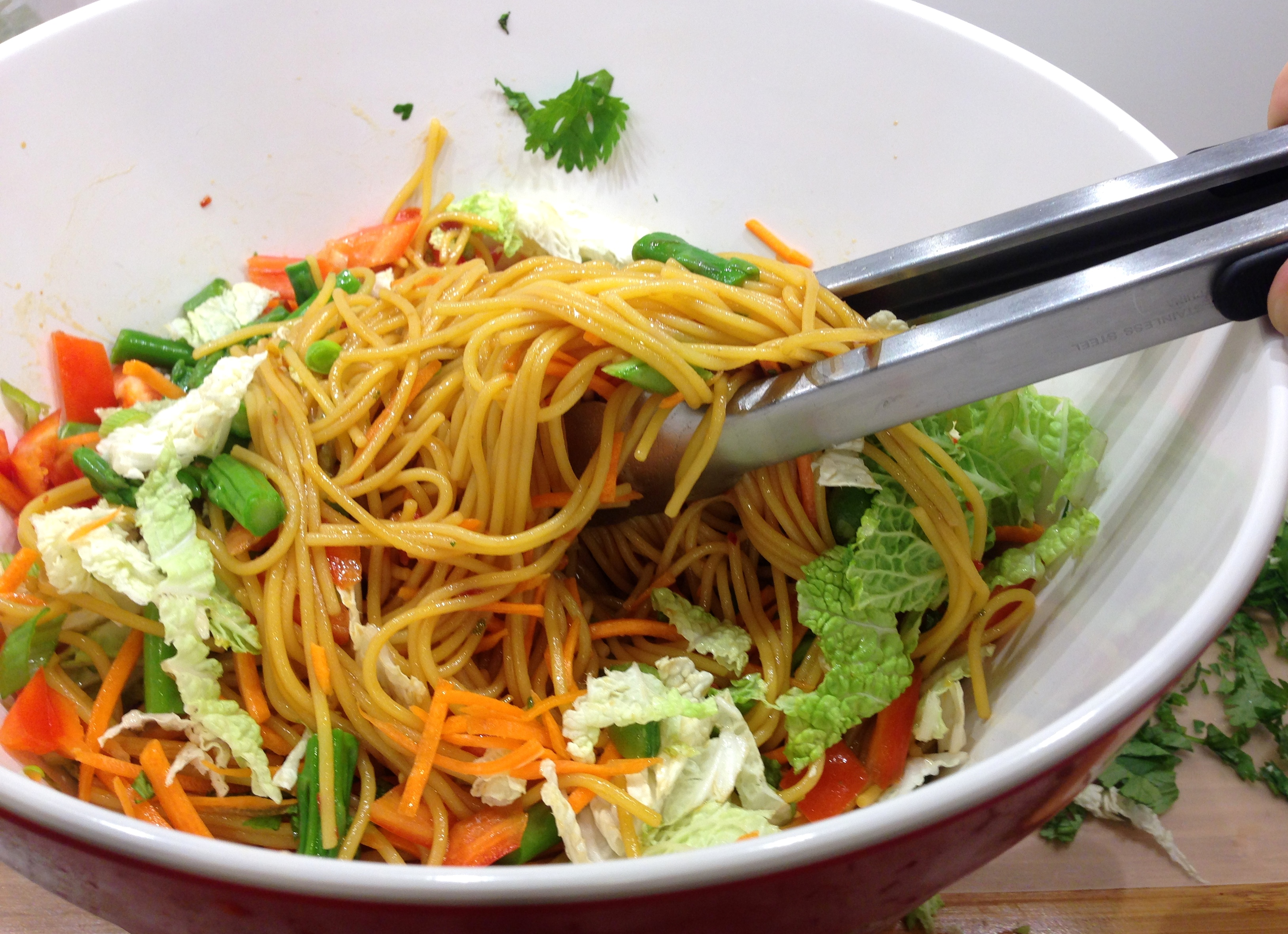 Toss veggies and noodles
